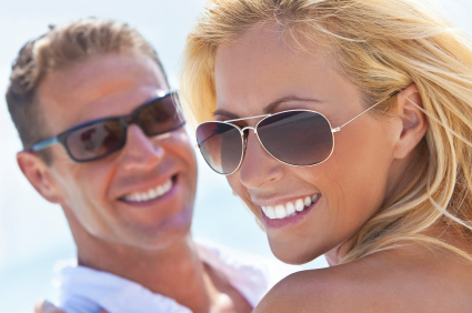 Smiling couple with dental veneers